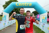 Press Eye - Belfast - Northern Ireland - 5th June 2016 - . Paul Curley and Joe Norney from Belfast win the first ever Centra 5k pairs run for Action Cancer at Ormeau Park.. Over 100 families, friends and colleagues paired up today (Sunday 5th June) for the inaugural Centra Run Together event at Ormeau Park, raising vital funds for local charity Action Cancer. . Run Together is a set of four 5k races taking place across Belfast, Mid Ulster and Derry between June and October which encourage you to run with your partner, son, daughter, friend or neighbour. . Picture by Kelvin Boyes / Press Eye . .
