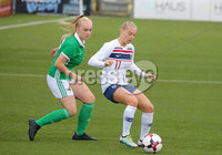 Press Eye - Belfast - Northern Ireland - 8th October 2019. European Women\'s U19 Championship 2020 Qualifying Round -  Northern Ireland Vs Norway, Seaview. Northern Ireland\'s Beth Chalmers with Norway\'s Runa Lillegard.. Picture by Jonathan Porter/PressEye