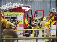 Press Eye - Belfast - Northern Ireland -  Friday 15th November 2019. Picture by Jonathan Porter / Press Eye. Duncrue Street fire scene this morning.. Four appliances were initially sent to the scene, but this was increased to 13, including appliances with cranes.. Fumes from the blaze could be smelt as commuters made their way into Belfast on Friday. Duncrue Street is closed in both directions.. Four appliances were initially sent to the scene, but this was increased to 13, including appliances with cranes..