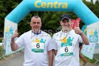 Press Eye - Belfast - Northern Ireland - 5th June 2016 - . Trevor Magill and Michael McCormack take part in the first ever Centra 5k pairs run for Action Cancer at Ormeau Park.. Over 100 families, friends and colleagues paired up today (Sunday 5th June) for the inaugural Centra Run Together event at Ormeau Park, raising vital funds for local charity Action Cancer. . Run Together is a set of four 5k races taking place across Belfast, Mid Ulster and Derry between June and October which encourage you to run with your partner, son, daughter, friend or neighbour. . Picture by Kelvin Boyes / Press Eye . .