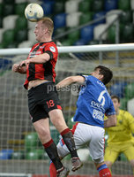 21/02/2020. Danske Bank Irish Premiership match between Linfield and Crusaders at The National Stadium.. Linfields Jimmy Callaher   in action with Crusaders Jordan Owens . Mandatory Credit  Inpho/Stephen Hamilton