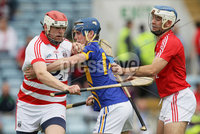 Munster GAA Hurling Intermediate Championship 2012 Semi-Final, Páirc Uí Chaoimh 24/6/2012. Cork vs Tipperary. Cork goalkeeper Stephen Nolan with support from Darragh Rodgers is tackled by Joe Gallagher of Tipperary. Mandatory Credit ©INPHO/Cathal Noonan