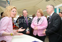 Press Eye - Belfast - Northern Ireland - 16th May 2019. Second day of the Balmoral Show, in partnership with Ulster Bank.  Pictured at Balmoral Park, outside Lisburn, are Ulster Bank\'s Dan McGinn(second from right) the Secretary of State for Northern Ireland Karen Bradley(centre) and Head of Ulster Bank Richard Donnan(right) who meet Clare Gallagher - Membership Manger with Women in Business at her  business stall.  Ulster Bank has provided space in its market at Balmoral Show to entrepreneurs from Ulster Bank\'s Entrepreneur Accelerator programme as well as small business customers. . Picture by Jonathan Porter/PressEye