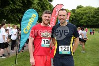 Press Eye - Belfast - Northern Ireland - 5th June 2016 - . Paul Curley and Joe Norney from Belfast  take part in the first ever Centra 5k pairs run for Action Cancer at Ormeau Park.. Over 100 families, friends and colleagues paired up today (Sunday 5th June) for the inaugural Centra Run Together event at Ormeau Park, raising vital funds for local charity Action Cancer. . Run Together is a set of four 5k races taking place across Belfast, Mid Ulster and Derry between June and October which encourage you to run with your partner, son, daughter, friend or neighbour. . Picture by Kelvin Boyes / Press Eye . .