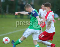 Press Eye Belfast - Northern Ireland 28th November 2017. School boys International - Northern Ireland Vs Poland at the Dub in south Belfast. . Northern Ireland\'s Chris Hutchinson with Poland\'s Nikodem Niski. Picture by Jonathan Porter/PressEye.com