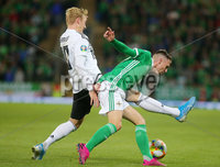 Press Eye - Belfast - Northern Ireland - 9th September 2019 . UEFA EURO Qualifier Group C at the National Stadium at Windsor Park, Belfast.  Northern Ireland Vs Germany. . Northern Ireland\'s Gavin Whyte with Germany\'s Julian Brandt.  . Photo by Jonathan Porter / Press Eye.