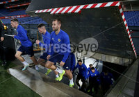 Press Eye - Belfast, Northern Ireland - 09th October 2019 - Photo by William Cherry/Presseye. Northern Ireland\'s Gavin Whyte, Jordan Thompson and Niall McGinn walk up the stairs and onto the pitch during Wednesday nights training session at Stadium Feijenoord ahead of Thursday nights UEFA Euro 2020 Qualifier against Netherlands in Rotterdam. Photo by William Cherry/Presseye