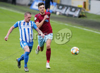Press Eye - Belfast - Northern Ireland - 27th July 2020 - . Ballymena United FC v Coleraine FC Sadler\'s Peaky Blinder Irish Cup Semi Final at the National Football Stadium at Windsor Park.. Ballymenas Adam Lecky with Coleraines Aaron Canning. Photo by Jonathan Porter Press Eye.