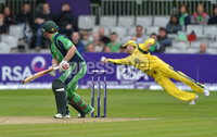 Mandatory Credit: Rowland White/Presseye. Cricket: One Day International. Teams: Ireland (green) v Australia (yellow). Venue: Stormont:. Date: 23rd June 2012. Caption: Paul Stirling looks round as Michael Cl;rake takes a diving catch