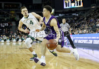 Press Eye - Belfast -  Northern Ireland - 01st December 2017 - Photo by William Cherry/Presseye. Manhattan College\'s Zane Waterman with Holy Cross\'s Caleb Green during Friday afternoons Basketball Hall of Fame Belfast Classic game at the SSE Arena, Belfast.