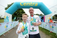 Press Eye - Belfast - Northern Ireland - 5th June 2016 - . Ed and Patric Bates  take part in the first ever Centra 5k pairs run for Action Cancer at Ormeau Park.. Over 100 families, friends and colleagues paired up today (Sunday 5th June) for the inaugural Centra Run Together event at Ormeau Park, raising vital funds for local charity Action Cancer. . Run Together is a set of four 5k races taking place across Belfast, Mid Ulster and Derry between June and October which encourage you to run with your partner, son, daughter, friend or neighbour. . Picture by Kelvin Boyes / Press Eye . .