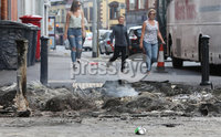 Press Eye - Belfast - Northern Ireland - 12th July 2017 . The day after the night before as bonfires smoulder as Orangemen take to the roads to celebrate the Battle of the Boyne.. Castlereagh Street.. Picture by Matt Mackey / presseye.com.