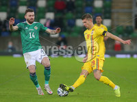Press Eye - Belfast - Northern Ireland - 12th November 2020. UEFA Nations League 2021 - Northern Ireland Vs Romina at The National Stadium at Windsor Park, Belfast.. Northern Irelands Stuart Dallas with Rominas Florin Tnase. Picture by Jonathan Porter/PressEye