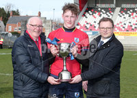 Press Eye Belfast - Northern Ireland 14th March 2019. Danske Bank U16High Schools Trophy Final. Craigavon High School(red) Vs Ballyclare Secondary School. . Craigavon lift the trophy after they win the final and are pictured with Ulster Rugby President Stephen Elliott(left) and Danske Bank Area Manager for Lisburn Chris Mitchell. . Picture by Jonathan Porter/PressEye.com