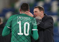Press Eye-Belfast-Northern Ireland -12th November 2020. National Football Stadium at Windsor Park, Belfast. . 12/11/2020. Northern Ireland Kyle Lafferty  with  manager Ian Baraclough  after  defeat against  Slovakia       during Thursday  night\'s UEFA Euro 2020  Play-off Final  at the National Football Stadium at Windsor Park,Belfast.. Mandatory Credit PressEye