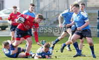 Press Eye Belfast - Northern Ireland 14th March 2019. Danske Bank U16High Schools Trophy Final. Craigavon High School(red) Vs Ballyclare Secondary School. . Ballyclare\'s Carson Todd tries to hold back Craigavon\'s 	. Sam Anderson. . Picture by Jonathan Porter/PressEye.com