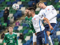 Press Eye-Belfast-Northern Ireland -12th November 2020. National Football Stadium at Windsor Park, Belfast. . 12/11/2020. Northern Ireland Jonny Evans  and Slovakia  Michal Duris and  Tomas Hubocan    during Thursday  night\'s UEFA Euro 2020  Play-off Final  at the National Football Stadium at Windsor Park,Belfast.. Mandatory Credit PressEye