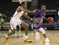 Press Eye - Belfast -  Northern Ireland - 30th November 2018 - Photo by William Cherry/Presseye. San Francisco\'s Jamaree Bouyea with Stephen F. Austin\'s Aaron Augustin during Friday afternoons game in the Goliath bracket of the Basketball Hall of Fame Belfast Classic at the SSE Arena, Belfast.