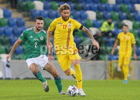Press Eye - Belfast - Northern Ireland - 12th November 2020. UEFA Nations League 2021 - Northern Ireland Vs Romania at The National Stadium at Windsor Park, Belfast.. Northern Irelands Conor McLaughlin with Romanias Eric Bicfalvi.. Picture by Jonathan Porter/PressEye
