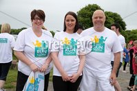Press Eye - Belfast - Northern Ireland - 5th June 2016 - . Valerie Thompson, Jennifer Morton and Michael Wright  take part in the first ever Centra 5k pairs run for Action Cancer at Ormeau Park.. Over 100 families, friends and colleagues paired up today (Sunday 5th June) for the inaugural Centra Run Together event at Ormeau Park, raising vital funds for local charity Action Cancer. . Run Together is a set of four 5k races taking place across Belfast, Mid Ulster and Derry between June and October which encourage you to run with your partner, son, daughter, friend or neighbour. . Picture by Kelvin Boyes / Press Eye . .