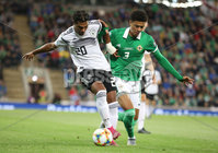 PressEye-Northern Ireland- 9th September  2019-Picture by Brian Little/PressEye. Northern Ireland  Jamel Lewis   and Germany  Serge Gnaby   during Monday\'s  European Championship Qualifying Group C match  at the National  Football Stadium at Windsor Park,Belfast.. Picture by Brian Little/PressEye .