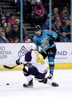 Press Eye - Belfast, Northern Ireland - 29th February 2020 - Photo by William Cherry/Presseye. Belfast Giants\' Liam Morgan with Guildford Flames\' Jesse Craige during Saturday nights Elite Ice Hockey League game at the SSE Arena, Belfast.    Photo by William Cherry/Presseye
