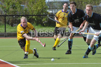 Mandatory Credit: Rowland White/Presseye. Men\'s Hockey: Irish Senior Cup Quarter-Final. Teams: Lisnagarvey (blue) v Pembroke Wanderers (yellow). Venue: Lisnagarvey. Date: 28th April 2012. Caption: Tim Hill of Pembroke glides the ball away