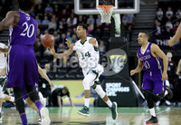 Press Eye - Belfast -  Northern Ireland - 01st December 2017 - Photo by William Cherry/Presseye. Manhattan College\'s Calvin Crawford with Holy Cross\'s Patrick Benzan during Friday afternoons Basketball Hall of Fame Belfast Classic game at the SSE Arena, Belfast.