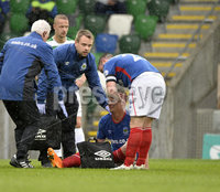 Press Eye - Belfast - Northern Ireland -14th July. Photo by Stephen Hamilton  / Press Eye.. Champions league qualifying match first leg between Linfield and Celtic at Windsor park in Belfast.. Linfields Mathew Clarke gets stretcherd off .