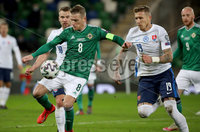 Press Eye - Belfast, Northern Ireland - 12th November 2020 - Photo by William Cherry/Presseye. Northern Ireland\'s Steven Davis with Slovakia\'s Juraj Kucka during Thursday nights UEFA Euro 2020 Play-Off Final at the National Football Stadium at Windsor Park.   Photo by William Cherry/Presseye