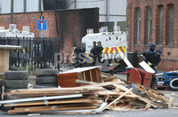 11th July 2018 - Picture by Matt Mackey / PressEye.com. The 11th night bonfire is dismantled in Cluan Place in East Belfast..