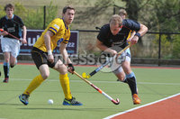 Mandatory Credit: Rowland White/Presseye. Men\'s Hockey: Irish Senior Cup Quarter-Final. Teams: Lisnagarvey (blue) v Pembroke Wanderers (yellow). Venue: Lisnagarvey. Date: 28th April 2012. Caption: Timmy Cockram, Lisnagarvey powers past a Pembroke defender