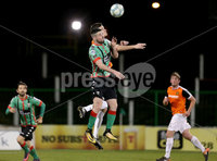 BetMcLean League Cup Round 3, The Oval, Belfast 10/10/2017. Glentoran vs Carrick Rangers. Glentoran\'s Tiarnan McNicholl jumps with Carrick Rangers\' Mark Surgenor. Mandatory Credit ©INPHO/Matt Mackey