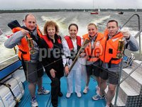Presseye Northern Ireland - 05th June 2012 Mandatory Credit - Photo-William Cherry/Presseye. Sports Minister Caral Ní Chuilín with Torch Bearer Eorann O\'Neill as the Olympic Flame makes its way across Lough Neagh on board a local fishing boat. The Torch travelled across the water from Antrim Harbour to Ballyronan on the final day of the Olympic Torch Relay. It also visited Newcastle, Downpatrick and Ballymena, as once again thousands of people came out to cheer the Torch despite the rain, before departing from Larne Harbour for Scotland at 4pm.