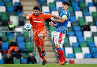 Danske Bank Premiership, National Football Stadium at Windsor Park, Belfast, Northern Ireland 17/10/2020. Linfield vs Carrick Rangers. Linfields Jimmy Callagher with Michael Smith of Carrick Rangers. Mandatory Credit INPHO/Declan Roughan