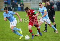 County Antrim Shield Final -  Windsor Park.  21.01.20. Cliftonville FC vs Ballymena United. Cliftonvilles Michael McCrudden with Ballymenas Scot Whiteside(left) and Leroy Millar. Mandatory Credit INPHO/Jonathan Porter