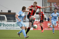 13th August 2019. Danske Bank Premiership.  Crusaders v Warrenpoint Town at Seaview Belfast.. Crusaders Ross Clarke with Warrenpoints Ciaran OConnor. Mandatory Credit : Stephen Hamilton/Inpho