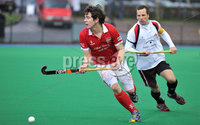 Mandatory Credit: Rowland White/Presseye. Hockey: Super 9\'s Finals. Teams: Dale Dragons (white) v Cookstown Maverics (red). Venue: Banbridge. Date: 25th April 2012. Caption: Mark Crooks, Maverics and Peter Caruth, Dragons