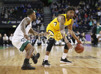 Press Eye - Belfast -  Northern Ireland - 02nd December 2017 - Photo by William Cherry/Presseye. Manhattan College\'s Zavier Turner with Towson College\'s Brian Starr during Saturday evenings Championship game of the Basketball Hall of Fame Belfast Classic at the SSE Arena, Belfast.  Photo by William Cherry/Presseye