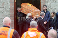 Press Eye - Belfast - Northern Ireland - 11th July 2018. Funeral for road racer William Dunlop at Garryduff Presbyterian Church outside Ballymoney in Co. Antrim.  The 32-year-old was killed while participating in the practise session of the Skerries 100 in Co. Dublin lat Saturday.  William\'s father Robert was also buried from Garryduff Presbyterian Church when he died at the North West 200 road race in 2008.. William Dunlop\'s family carry his coffin from the church after the funeral service as fellow road racer Glenn Irwin looks on. . Picture by Jonathan Porter/PressEye