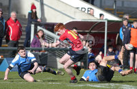 Press Eye Belfast - Northern Ireland 14th March 2019. Danske Bank U16High Schools Trophy Final. Craigavon High School(red) Vs Ballyclare Secondary School. . Craigavon\'s pushes forward to score a try.. Picture by Jonathan Porter/PressEye.com