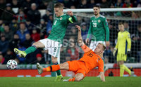 Press Eye - Belfast, Northern Ireland - 16th November 2019 - Photo by William Cherry/Presseye. Northern Ireland\'s Steven Davis with Netherlands\' Donny van de Beek during Saturday nights UEFA Euro 2020 Qualifier at the National Stadium, Belfast.     Photo by William Cherry/Presseye