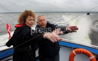 Presseye Northern Ireland - 05th June 2012 Mandatory Credit - Photo-William Cherry/Presseye. Sports Minister Caral Ní Chuilín as the Olympic Flame makes its way across Lough Neagh on board a local fishing boat. The Torch travelled across the water from Antrim Harbour to Ballyronan on the final day of the Olympic Torch Relay. It also visited Newcastle, Downpatrick and Ballymena, as once again thousands of people came out to cheer the Torch despite the rain, before departing from Larne Harbour for Scotland at 4pm.