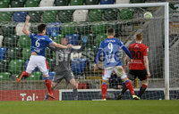 21/02/2020. Danske Bank Irish Premiership match between Linfield and Crusaders at The National Stadium.. Linfields  Jimmy Callaher heads the blues into a 3-0 lead. Mandatory Credit  Inpho/Stephen Hamilton