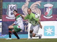 Press Eye - Belfast  - 11th August 2012. Danske Bank Premiership game between Glentoran and Donegal Celtic at The Oval, Belfast.. Glentorans John McGuigan and Donegal Celtics Pat McShane in action at Saturdays Danske Bank Premiership Game. . ©Russell Pritchard / Presseye