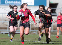 Press Eye Belfast - Northern Ireland 14th March 2019. Danske Bank Ulster Schools Girls X7s Senior Cup Final. Enniskillen Royal Grammar School(in red) vs Loreto Secondary School Letterkenny.. Enniskillen\'s India Daley pushes forward against Loreto\'s KEELEY LAFFERTY(right) . . Picture by Jonathan Porter/PressEye.com