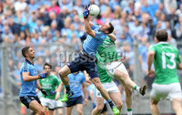 GAA Football All Ireland Senior Championship Quarter-Final, Croke Park, Dublin 2/8/2015. Dublin vs Fermanagh. Dublin's Denis Bastick and Ryan Jones of Fermanagh. Mandatory Credit ©INPHO/James Crombie.