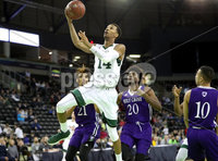 Press Eye - Belfast -  Northern Ireland - 01st December 2017 - Photo by William Cherry/Presseye. Manhattan College\'s Calvin Crawford with Holy Cross\'s Jehyve Floyd  during Friday afternoons Basketball Hall of Fame Belfast Classic game at the SSE Arena, Belfast.