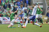 8th August 2018. Northern Ireland v Bosnia & Herzegovina at the national stadium in Belfast.. Northern Ireland\'s George Saville  in action with  Bosnia & Herzegovina\'s Gojko Clmirot.  Mandatory Credit: Stephen Hamilton /Presseye