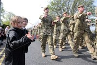 Presseye Ltd Northern Ireland 3rd May 2012. Mandatory Credit - Photograph by Declan Roughan / Presseye. Home Coming Parade - 2 Mercian Regiment - Holywood - 3rd May 2012. Aine Moore and Louis Baird of Sullivan Prep cheer on the troops (Emma - Features). 2 Mercian Regiment were welcomed back from Afganistan to their home base at Palace Barracks with a \'Homecoming\' parade through Holywood at the invitaion of North Down Borough council yesterday.Around 450 Soldiers paraded led by the Regimental Mascot - Lance Corporal Derby (a Ram) and the Band of the Prince of Wales\' Division.